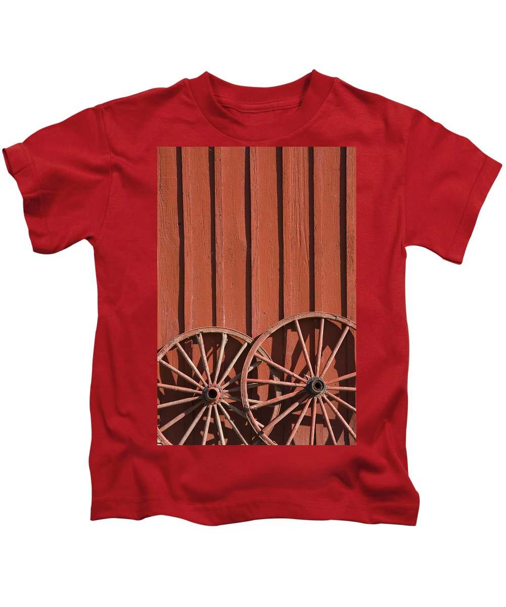 Wheel Wheels Wagon Old Red Barn Antique Past History Rural Country Kids T-Shirt featuring the photograph Old Wagon Wheels IIi by Andrei Shliakhau