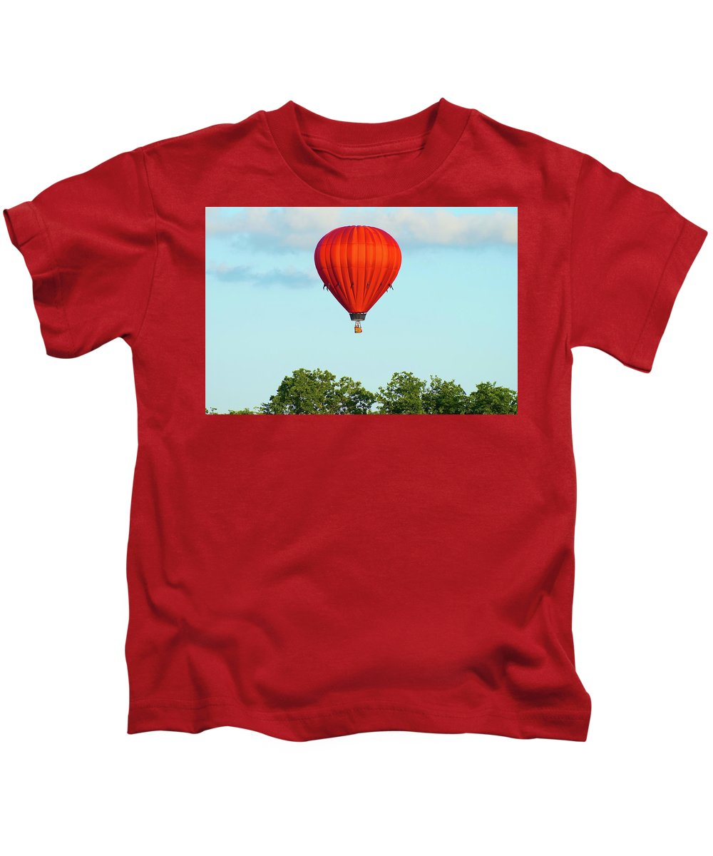 Balloons Kids T-Shirt featuring the photograph Red Above The Trees by Linda Cupps