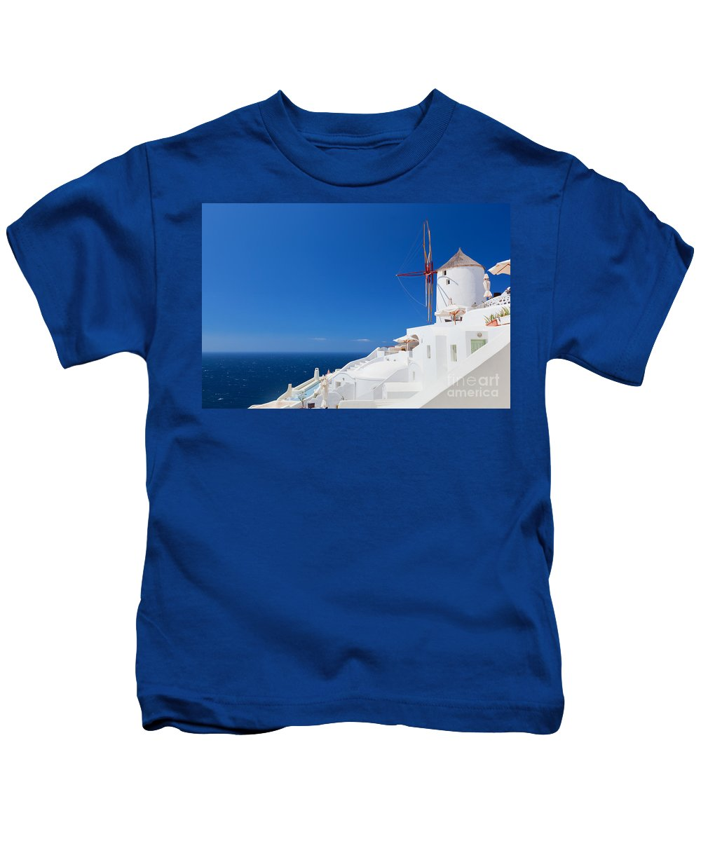 Santorini Kids T-Shirt featuring the photograph Oia Town On Santorini Island Greece by Michal Bednarek