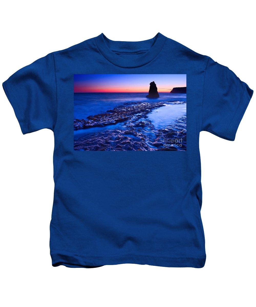 Davenport Kids T-Shirt featuring the photograph Dramatic Sunset View Of A Sea Stack In Davenport Beach Santa Cruz. by Jamie Pham