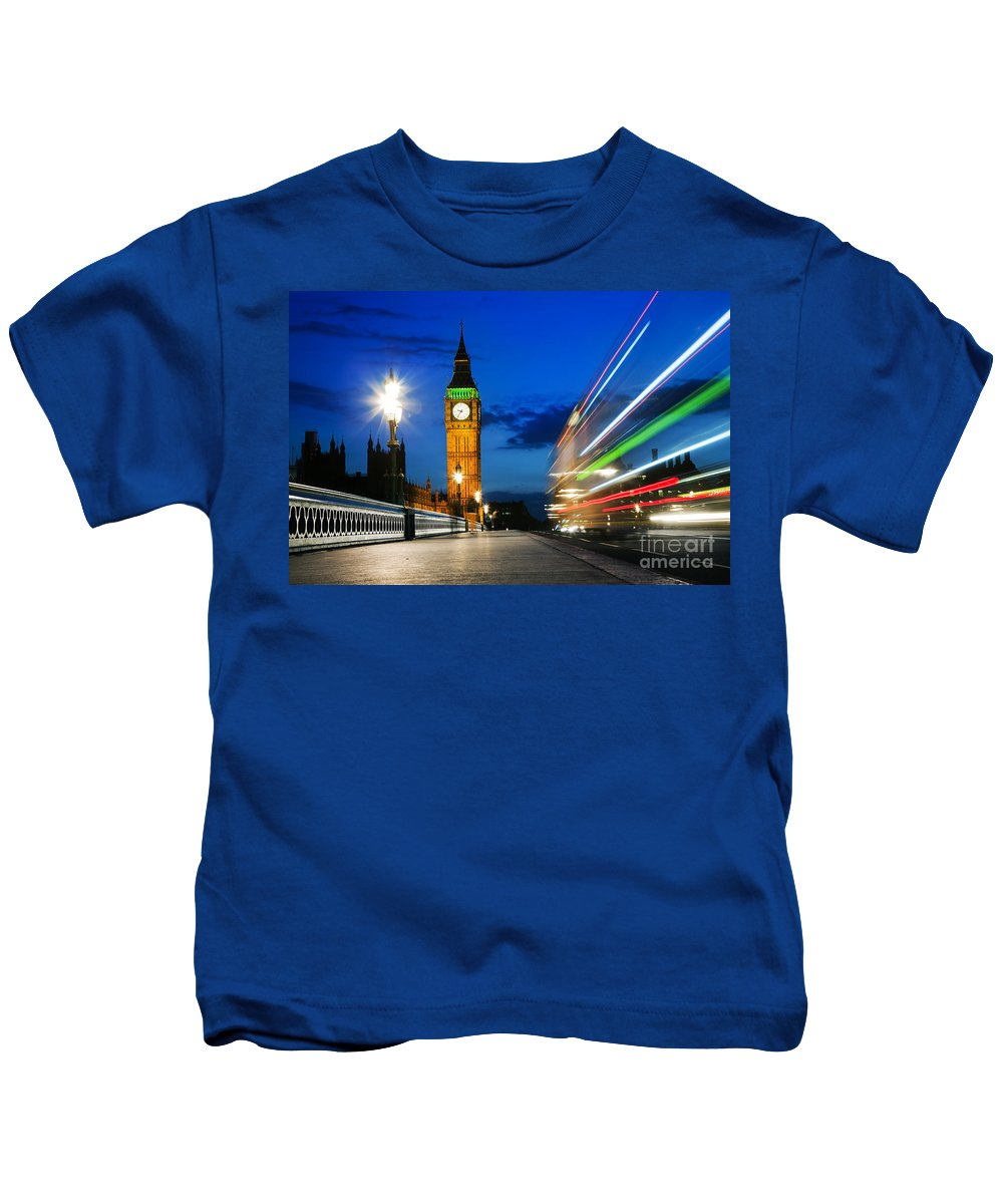 London Kids T-Shirt featuring the photograph London Uk Red Bus In Motion And Big Ben At Night by Michal Bednarek