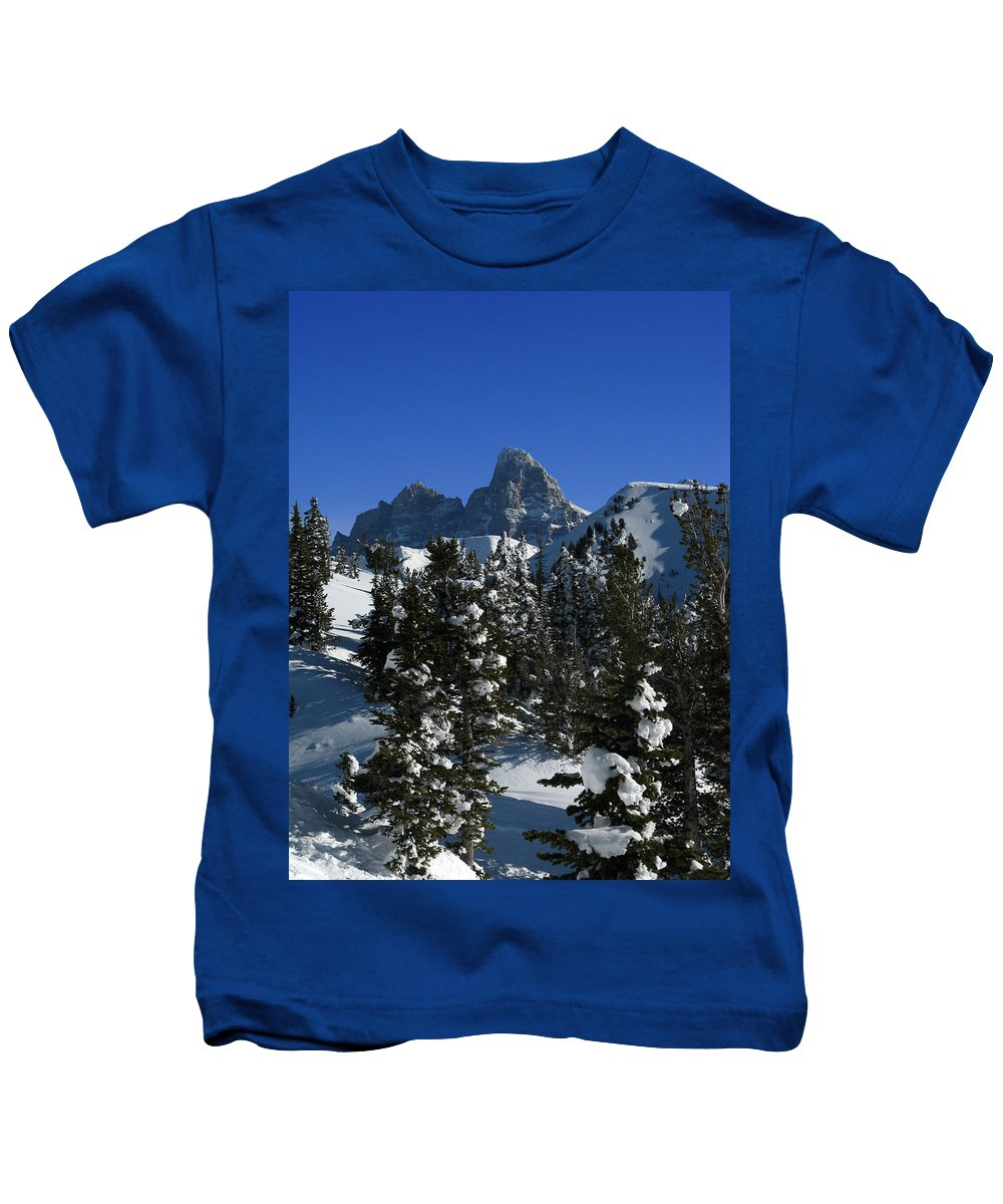 Grand Teton Kids T-Shirt featuring the photograph Towering Above Lies The Grand by Raymond Salani III