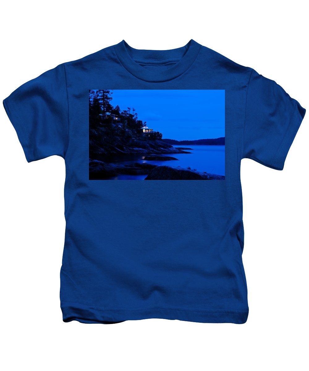 Backlit Kids T-Shirt featuring the photograph Illuminated Cabin In The Dark At The Seaside by U Schade