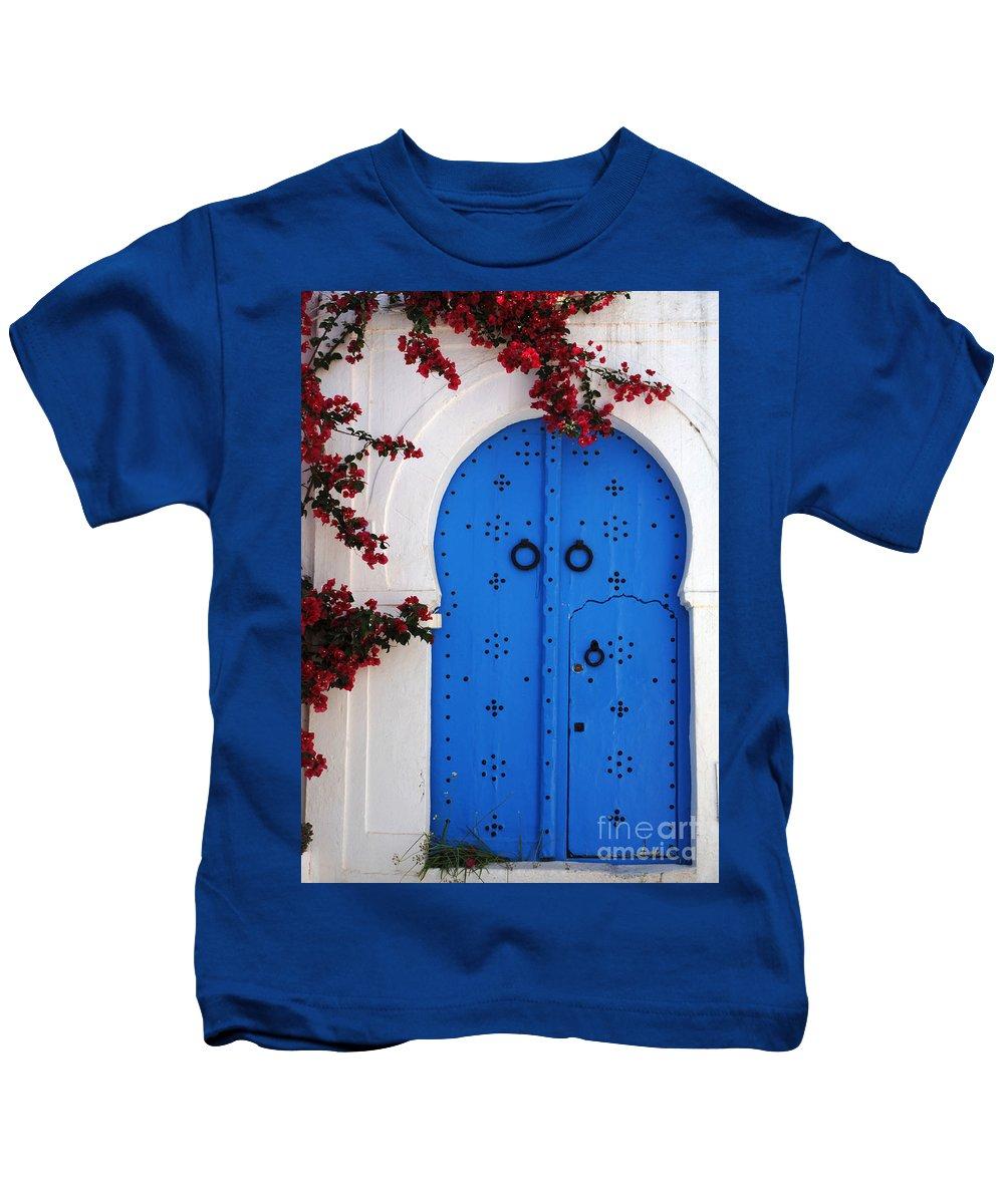 Door Kids T-Shirt featuring the photograph Doorway In Tunisia 1 by Bob Christopher