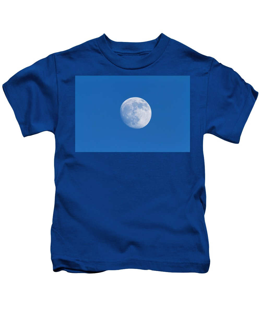 Blue Skies Kids T-Shirt featuring the photograph Full Moon. Sky Photographed by Philippe Henry