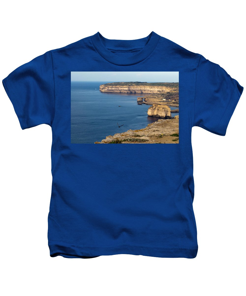 Calm Kids T-Shirt featuring the photograph The Flight Over Dwejra by Focus Fotos