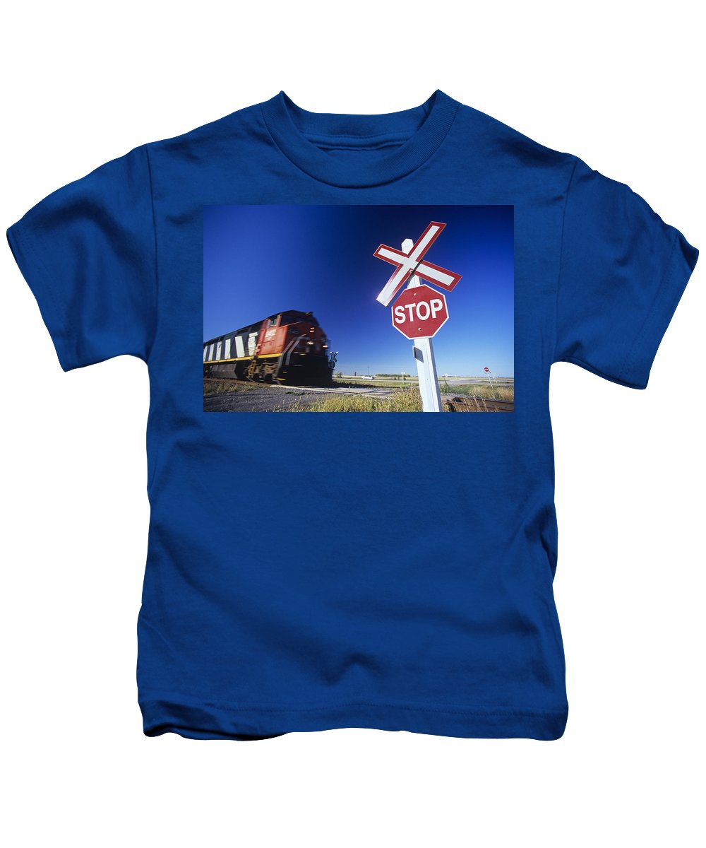 Colour Image Kids T-Shirt featuring the photograph Train Passing Railway Crossing by Dave Reede