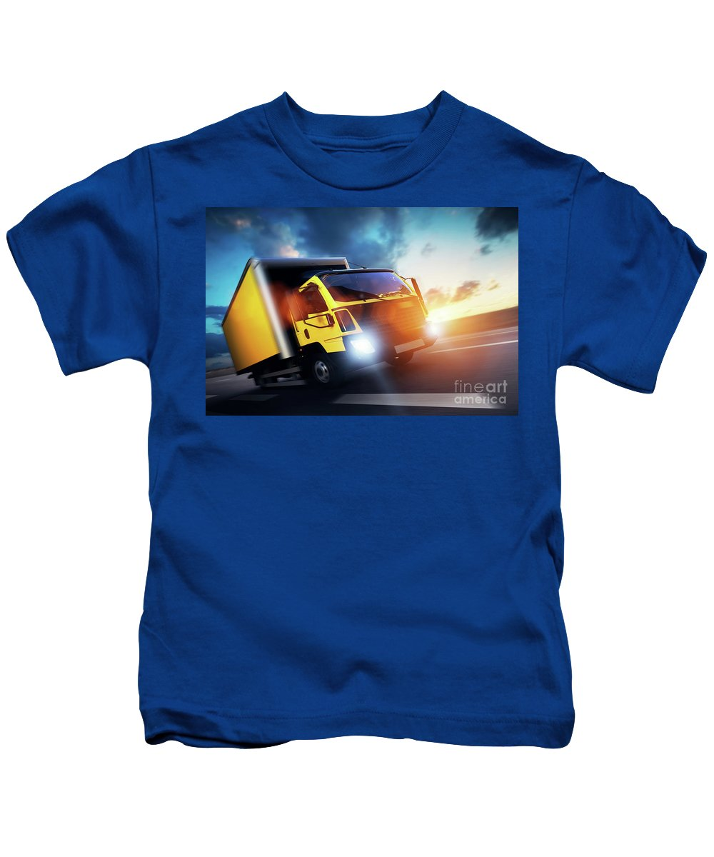 Truck Kids T-Shirt featuring the photograph Commercial Cargo Delivery Truck With Trailer Driving On Highway At Sunset. by Michal Bednarek