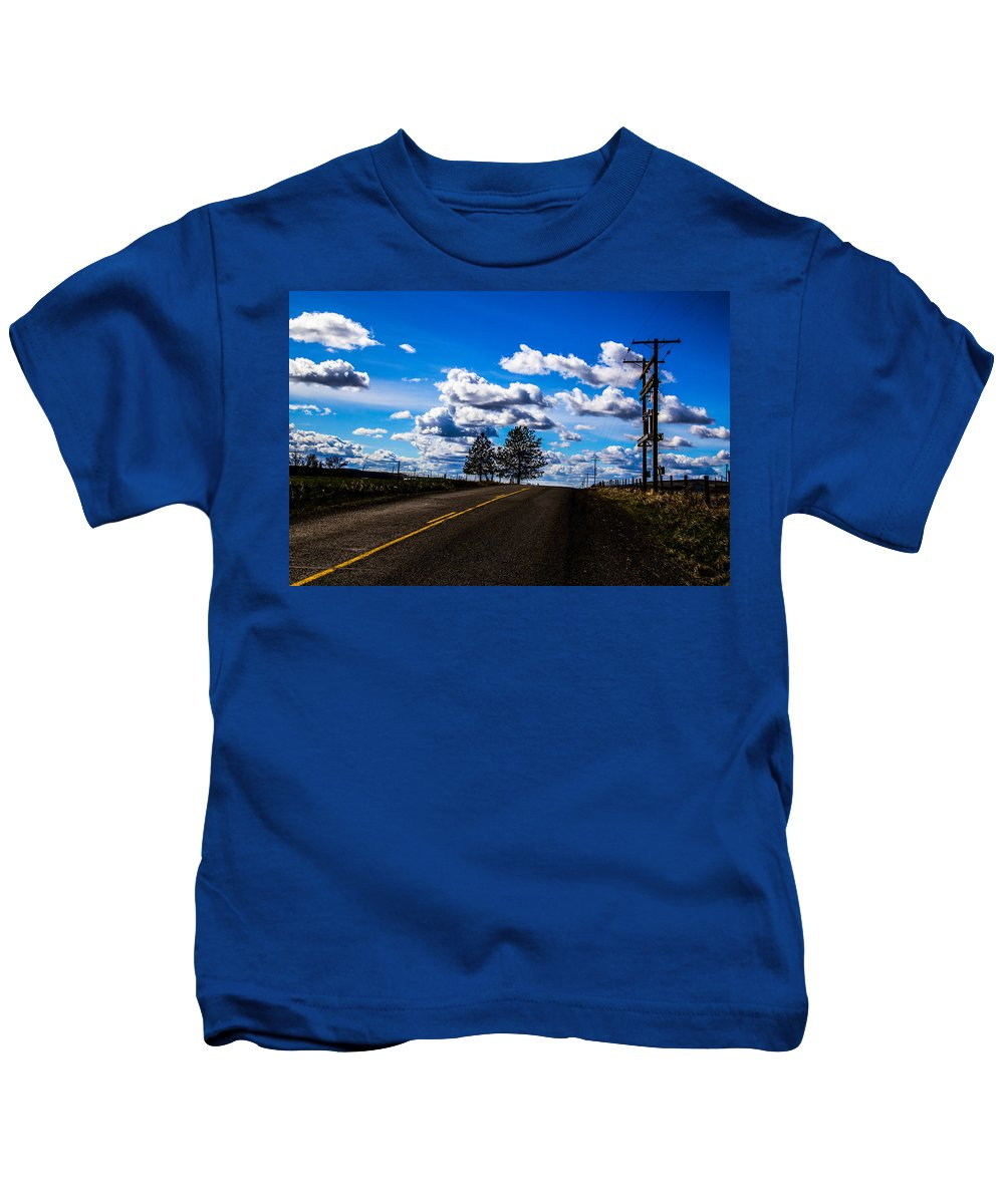 Kids T-Shirt featuring the photograph Journey Home by Angus Hooper Iii