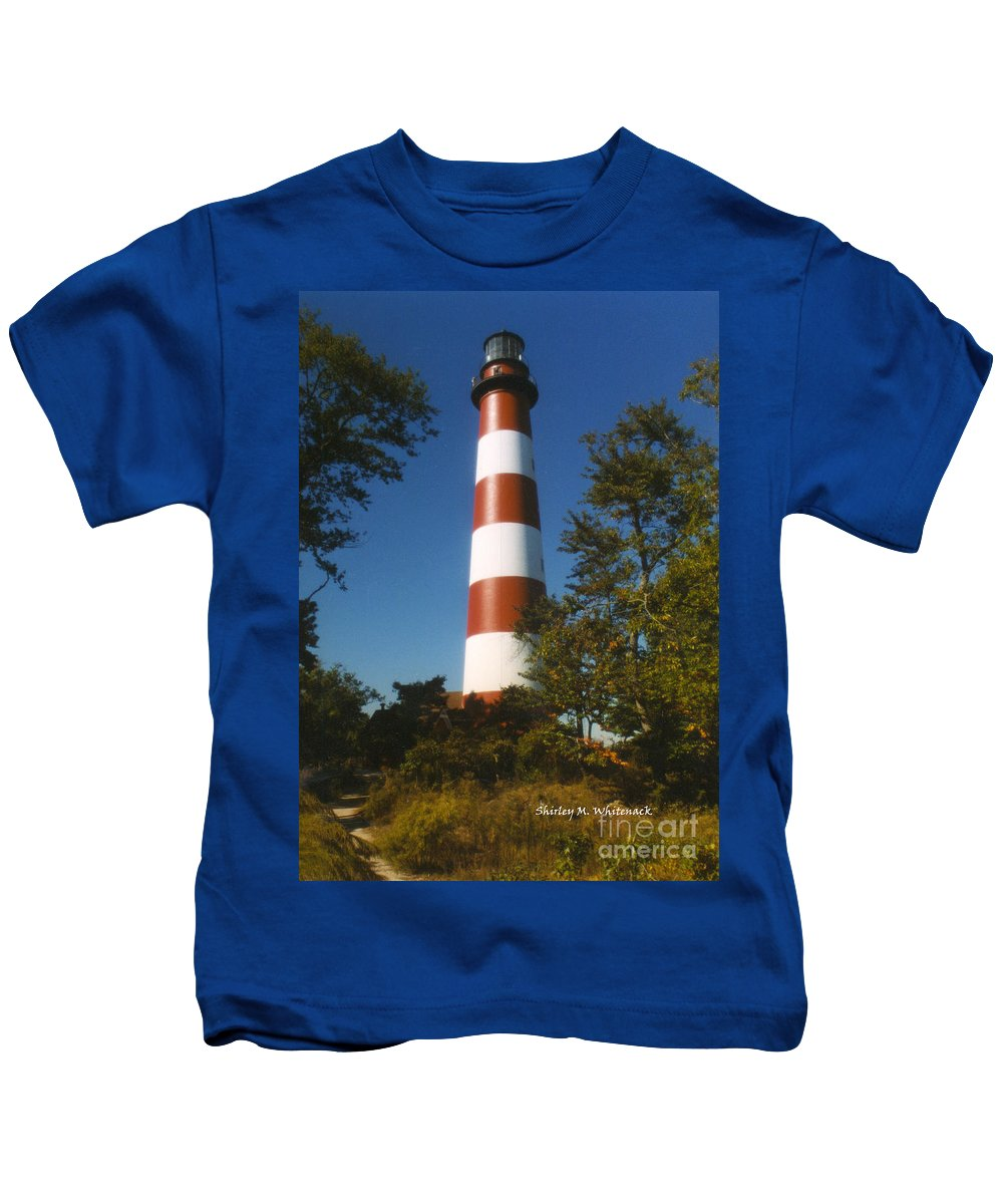 Assateague Light; Lighthouse; Red And White Stripes; Chincoteague; Pony Swim; Eastern Shore; Virginia Kids T-Shirt featuring the photograph Assateague Light by Shirley Whitenack