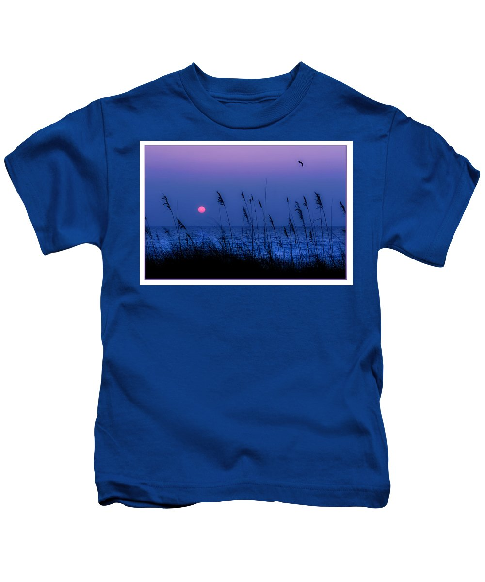 Grass Kids T-Shirt featuring the photograph Grasses Frame The Setting Sun In Florida by Mal Bray