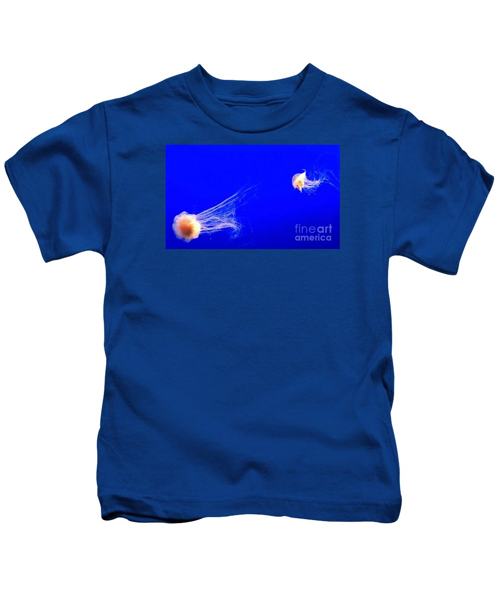 Ocean Kids T-Shirt featuring the photograph The Chase by Vanessa Palomino