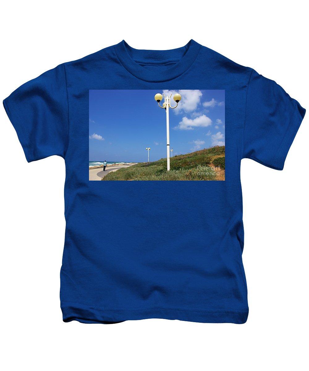 Tel Aviv Kids T-Shirt featuring the photograph walkway along the Tel Aviv beach by Zal Latzkovich