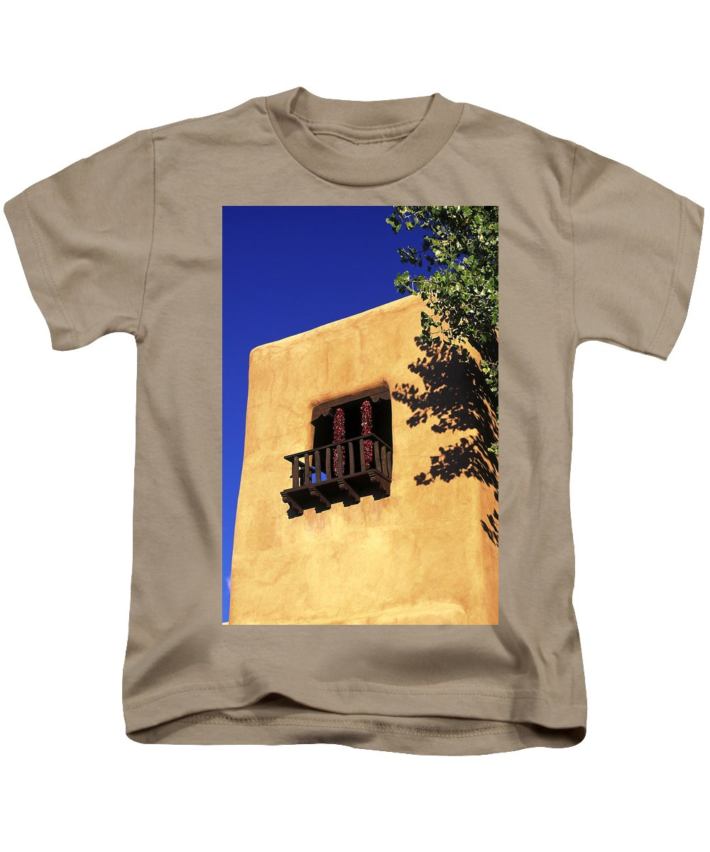 Adobe Wall Kids T-Shirt featuring the photograph Adobe And Ristras by Sally Weigand