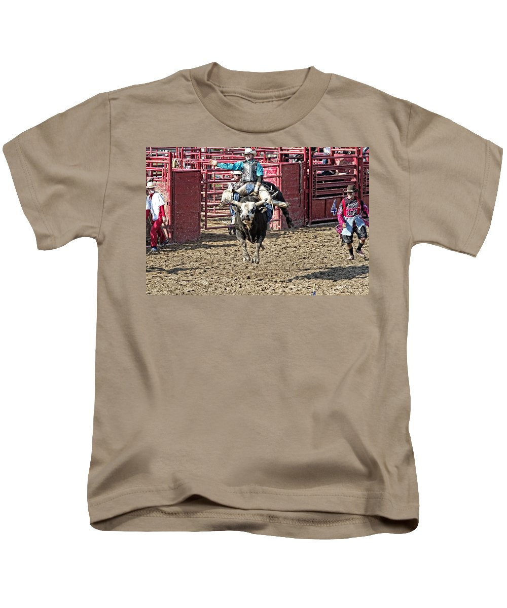 Bullriding Kids T-Shirt featuring the photograph All Four Feet Up by Alice Gipson
