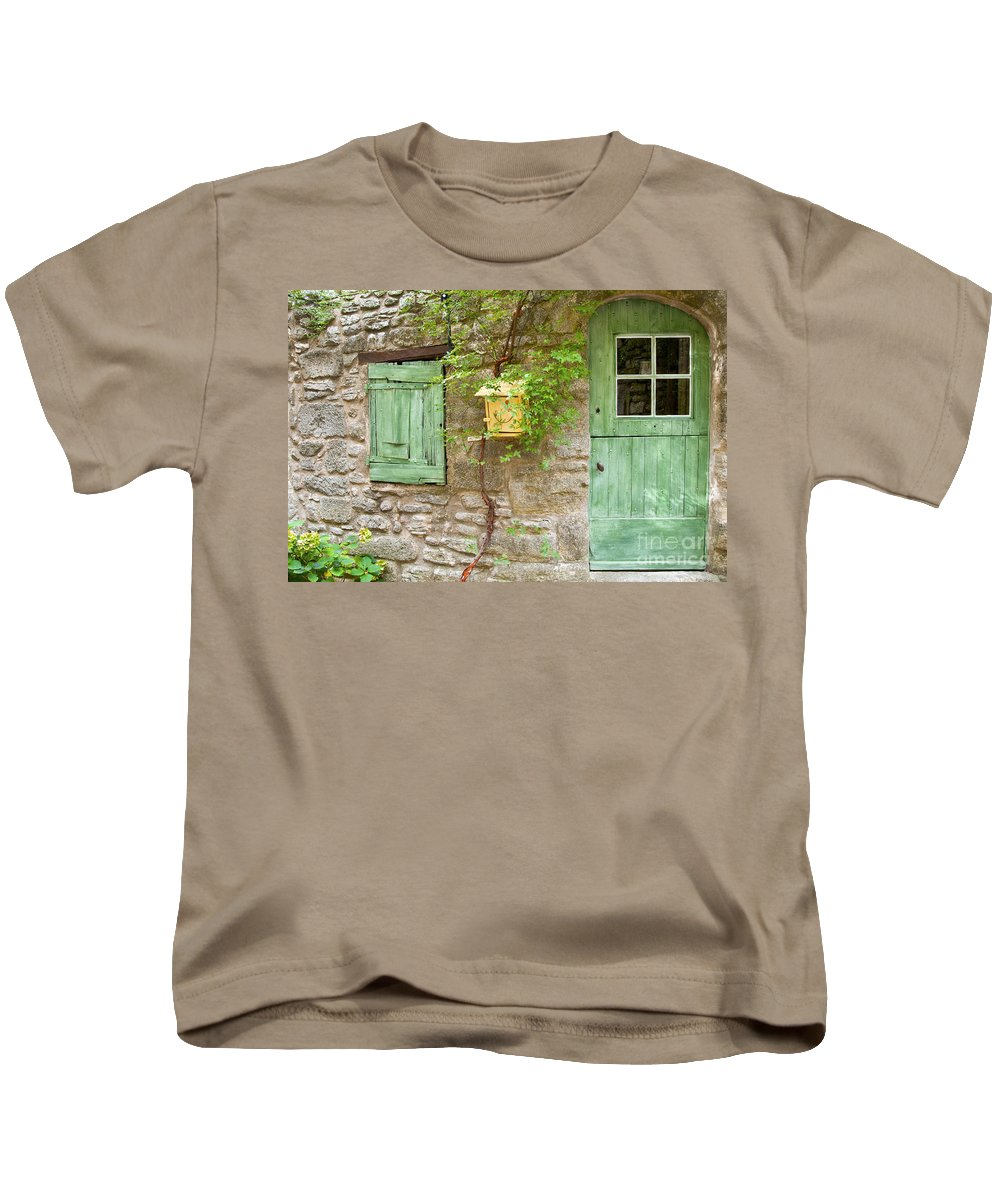 Saignon France Door Doors Bed And Breakfast Window Windows Shutter Shutters Street Streets Stone Structure Structures Building Buildings Provence Village Villages City Cities Cityscape Cityscapes Architecture Kids T-Shirt featuring the photograph Bed And Breakfast by Bob Phillips