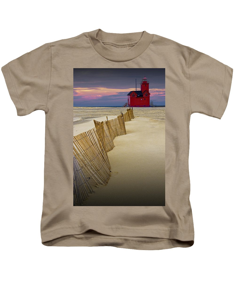 Art Kids T-Shirt featuring the photograph Big Red Lighthouse With Sand Fence At Ottawa Beach by Randall Nyhof