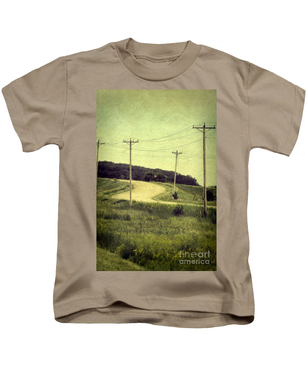 Road Kids T-Shirt featuring the photograph Country Dirt Road And Telephone Poles by Jill Battaglia