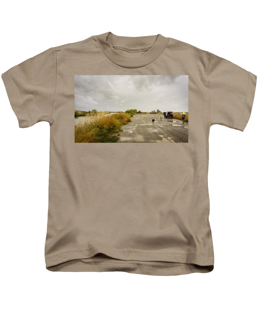 Dirt Kids T-Shirt featuring the photograph Dogs And Truck On A Muddy Dirt Road by Helix Games Photography