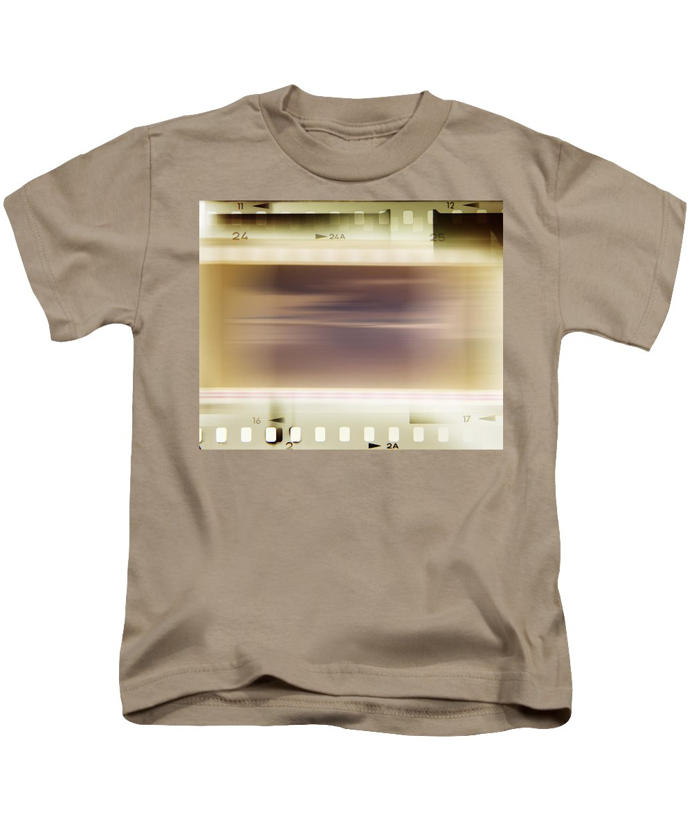 Background Kids T-Shirt featuring the photograph Film Strips by Les Cunliffe