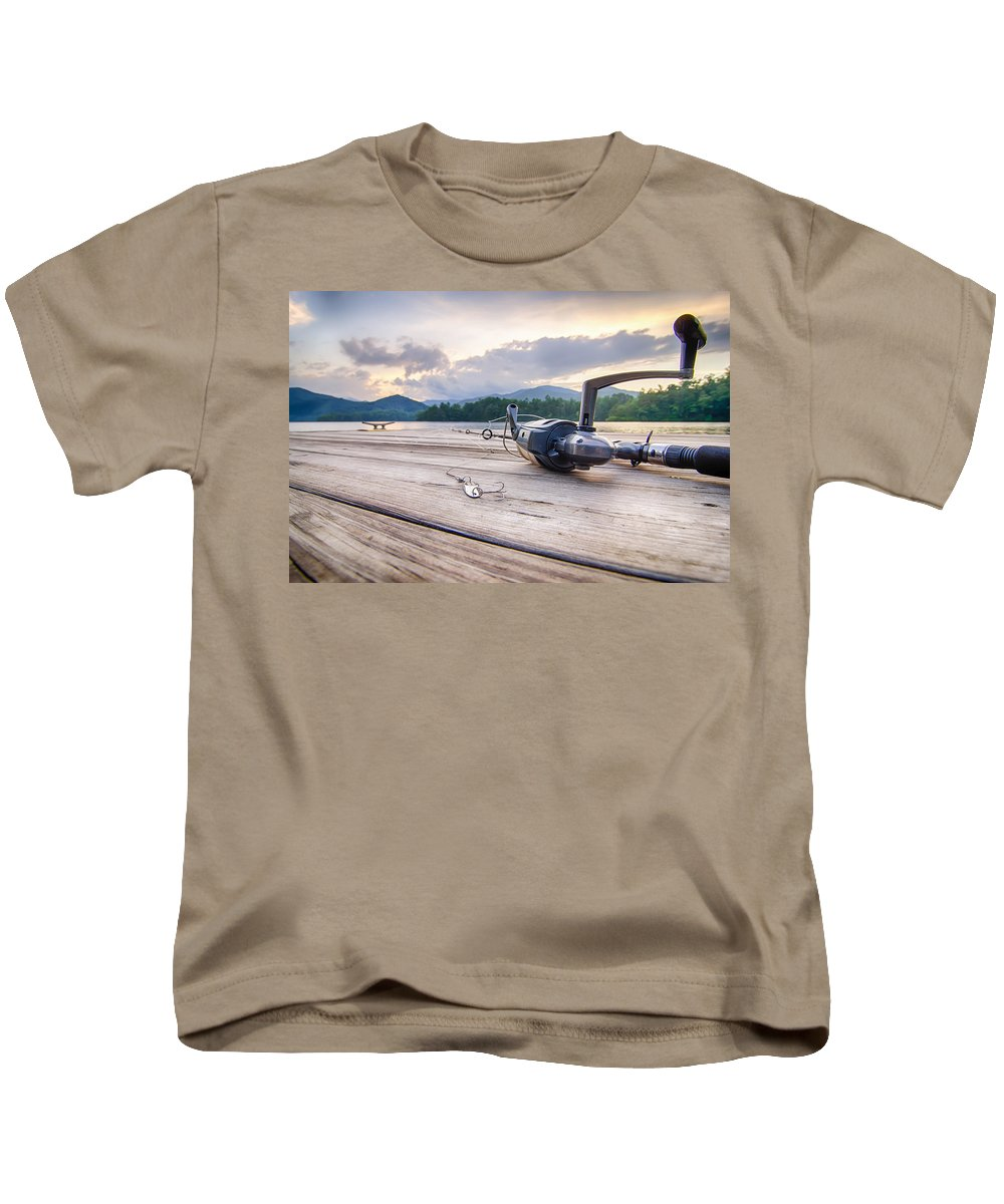 Accessories Kids T-Shirt featuring the photograph Fishing Tackle On A Wooden Float With Mountain Background In Nc by Alex Grichenko