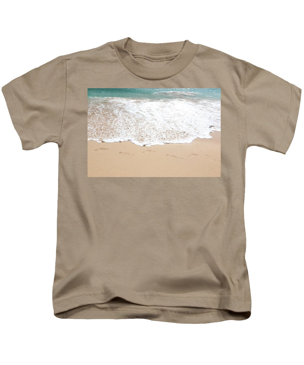 Beaches Kids T-Shirt featuring the photograph Footprints In The Sand by Athena Mckinzie
