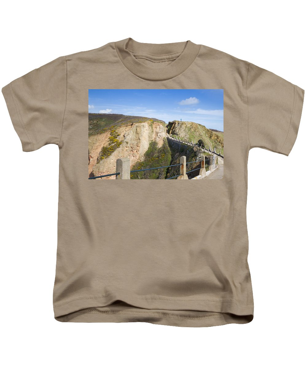 La Coupee Kids T-Shirt featuring the photograph La Coupee On Sark by Chris Smith