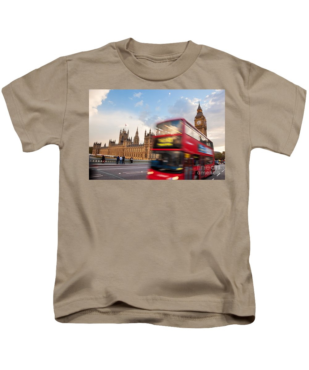 London Kids T-Shirt featuring the photograph London The Uk Red Bus In Motion And Big Ben by Michal Bednarek