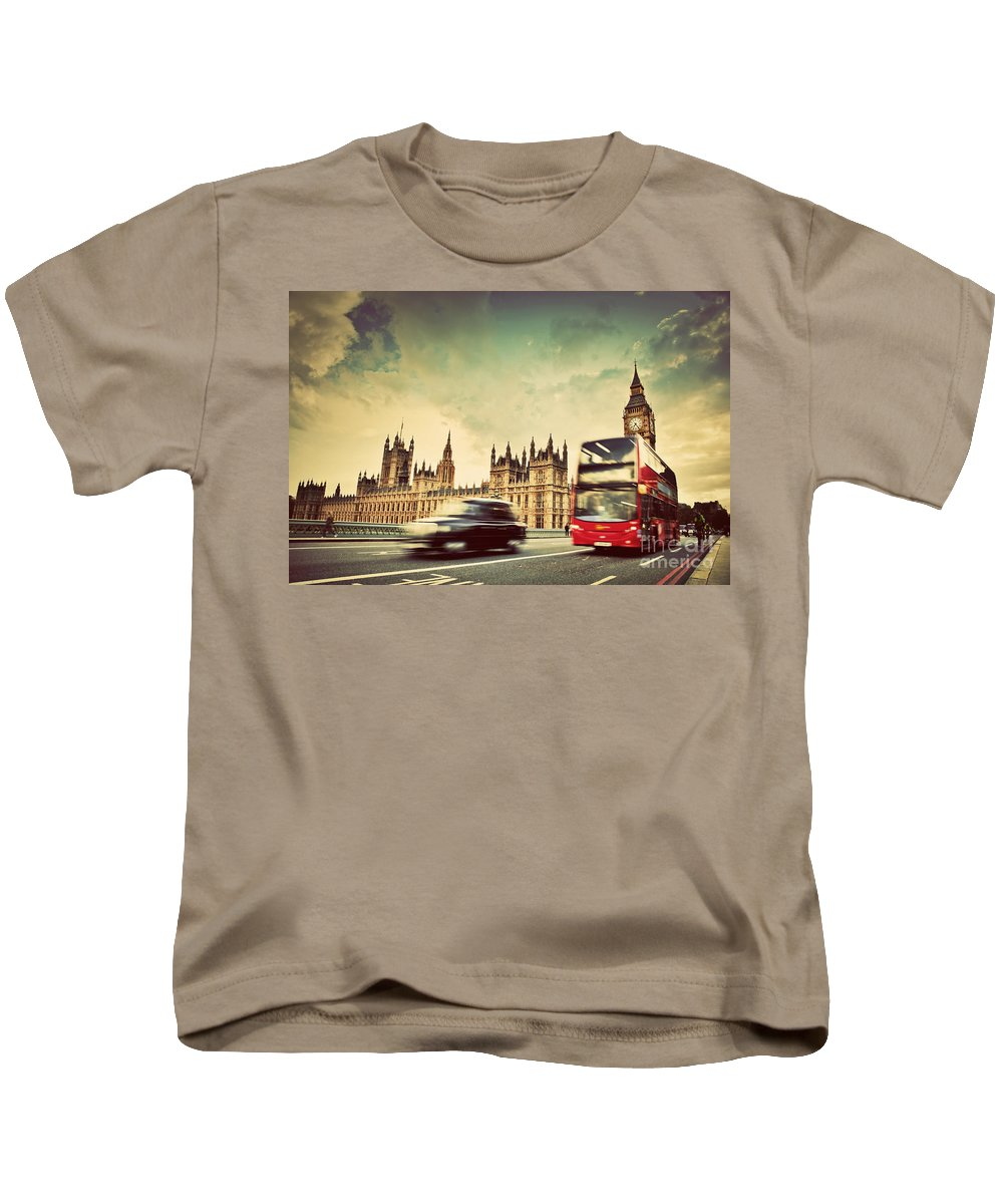 London Kids T-Shirt featuring the photograph London The Uk Red Bus Taxi Cab In Motion And Big Ben by Michal Bednarek