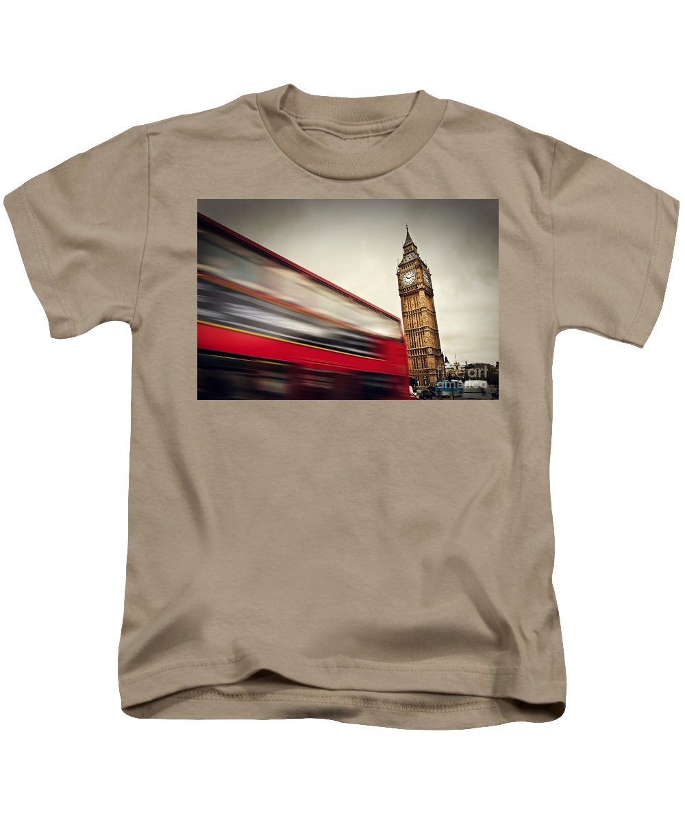 London Kids T-Shirt featuring the photograph London Uk Red Bus In Motion And Big Ben by Michal Bednarek