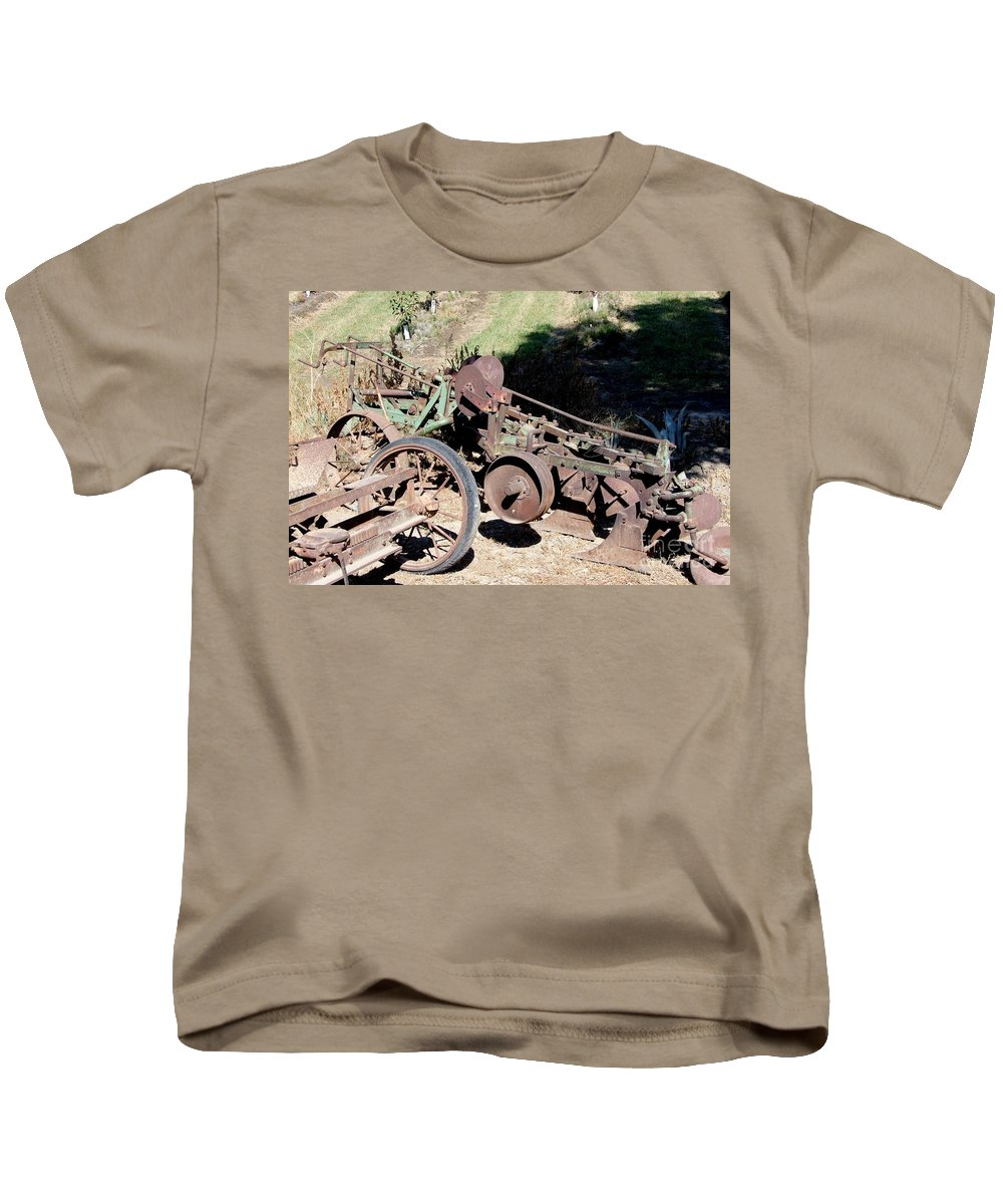 Mary Deal Kids T-Shirt featuring the photograph New Crop Antiquated Plow by Mary Deal