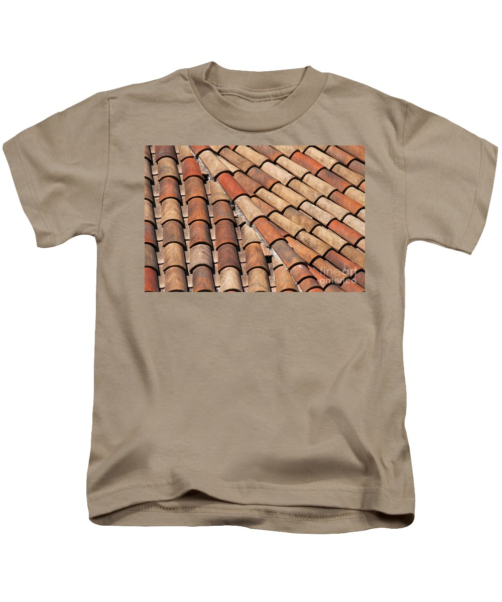 Bonnieux France Tiled Rooftops Patterned Rooftop Tile Tiles Cityscape Cityscapes Provence Kids T-Shirt featuring the photograph Patterned Tiles by Bob Phillips