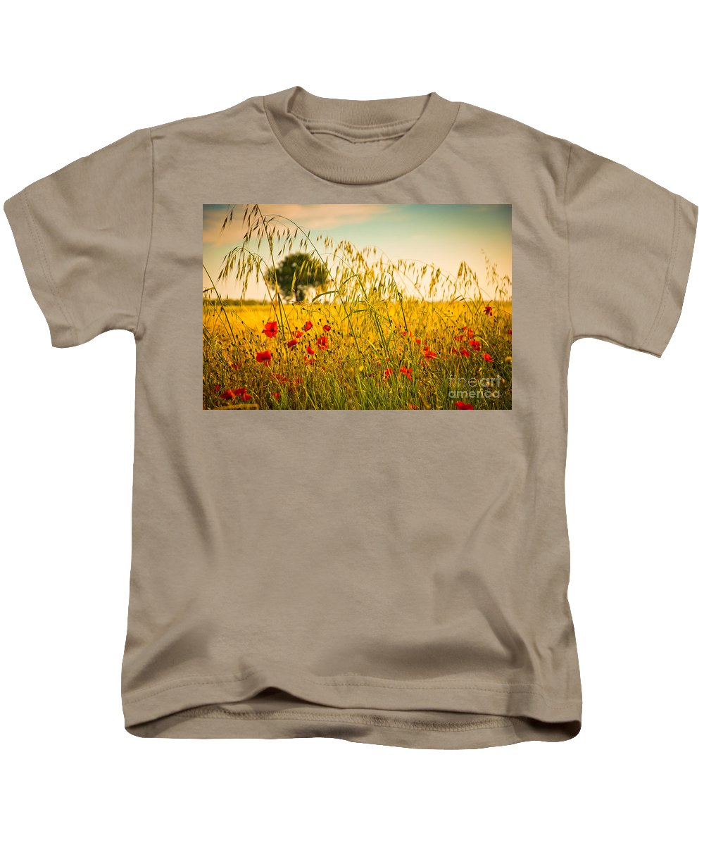 Field Kids T-Shirt featuring the photograph Poppies With Tree In The Distance by Silvia Ganora