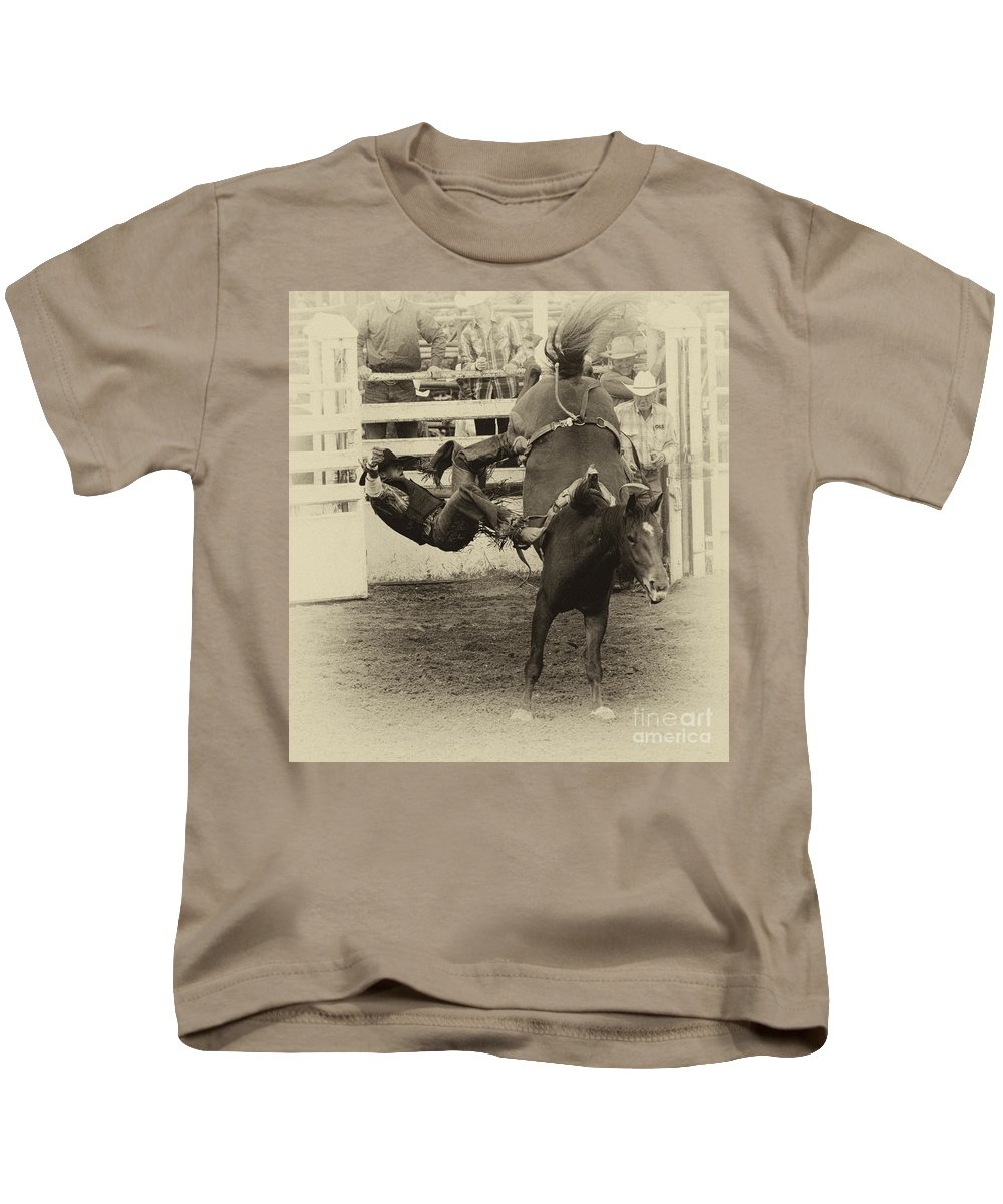 Horse Riding Kids T-Shirt featuring the photograph Rodeo Learning To Fly by Bob Christopher