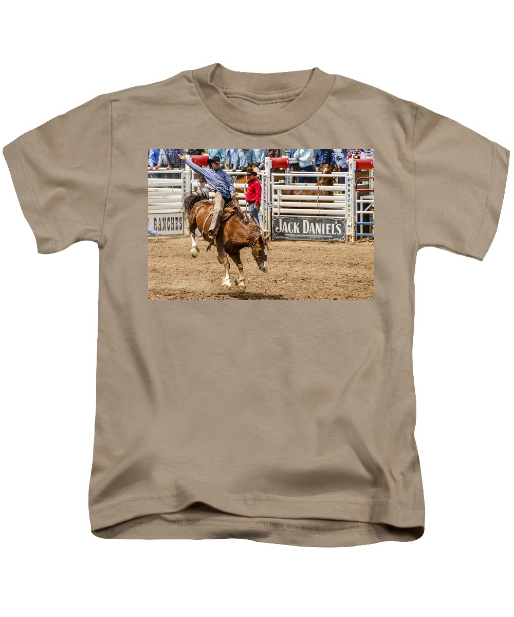 Rodeo Kids T-Shirt featuring the photograph Rodeo Ride by Jon Berghoff