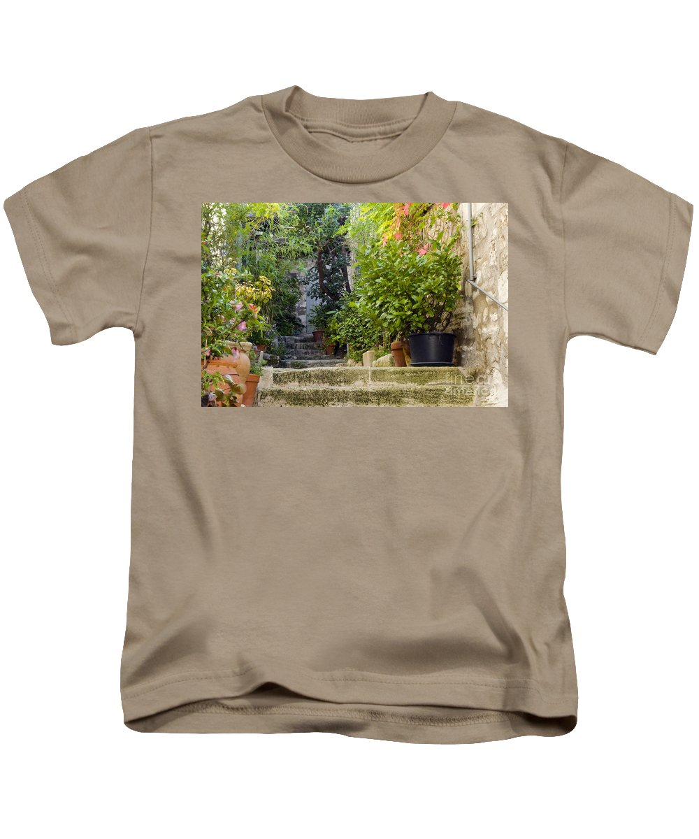 Les Baux France Step Steps Pot Pots Foliage Plant Plants Building Buildings Structure Structures Ruin Ruins Architecture City Cities Cityscape Cityscapes Provence Kids T-Shirt featuring the photograph Step Avenue by Bob Phillips