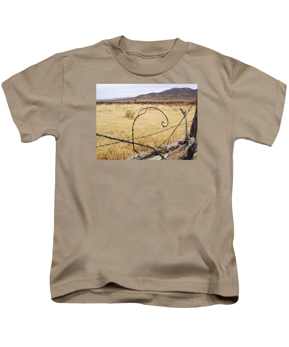 Fence Kids T-Shirt featuring the photograph Wired Western by Mike and Sharon Mathews
