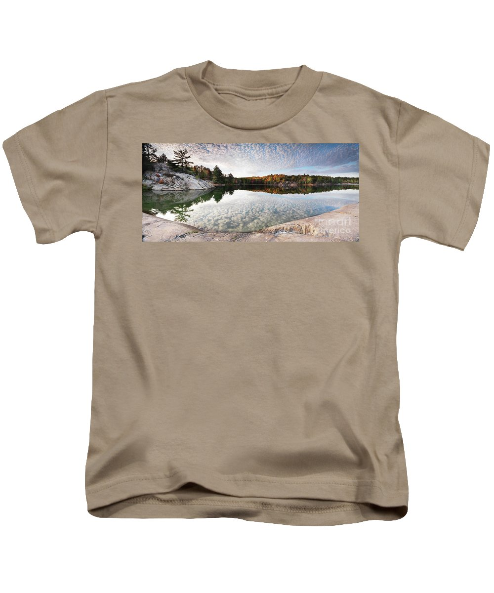 Lake Kids T-Shirt featuring the photograph Autumn Nature Lake Rocks And Trees Panorama by Oleksiy Maksymenko
