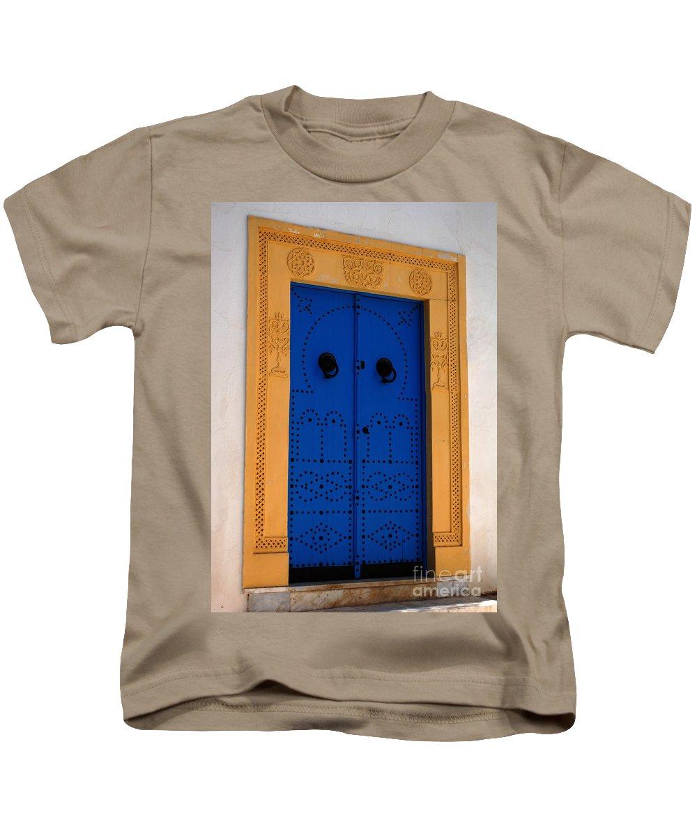 Door Kids T-Shirt featuring the photograph Doorway In Tunisia 2 by Bob Christopher