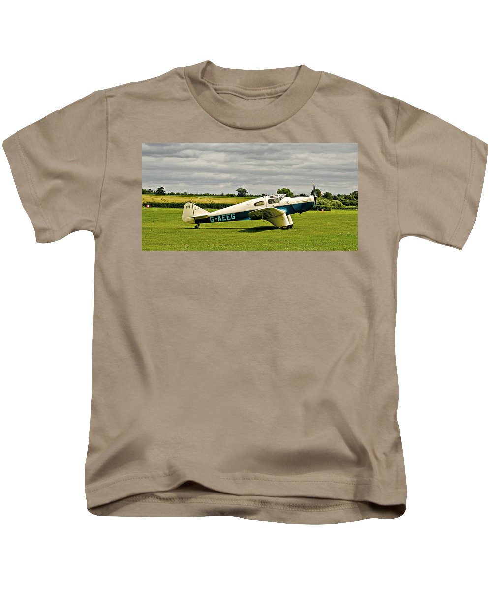 Miles M3 Falcon Aeroplane Kids T-Shirt featuring the photograph Miles M.3 Falcon Circa 1934 by Chris Thaxter