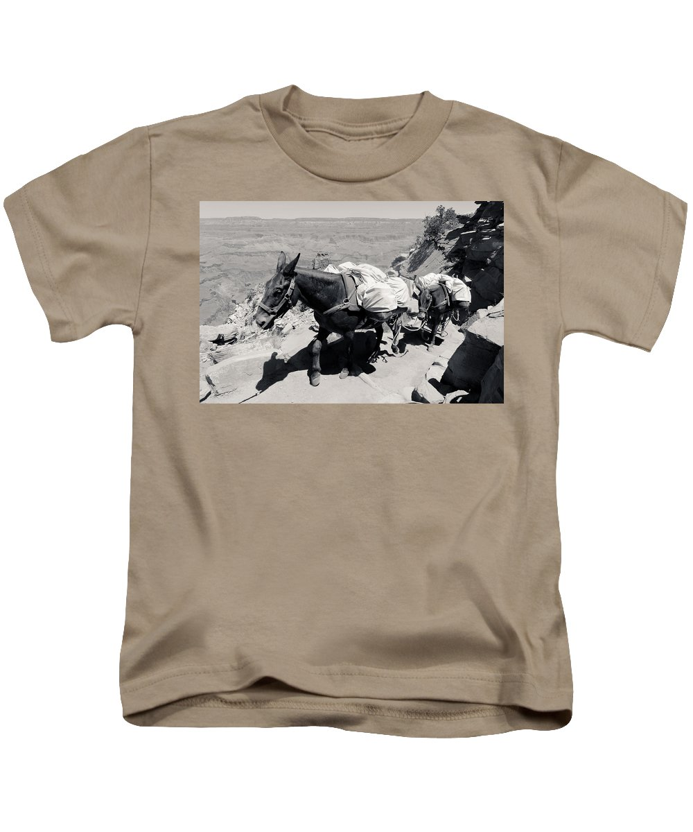 Mule Kids T-Shirt featuring the photograph Mule Train Bw by Julie Niemela