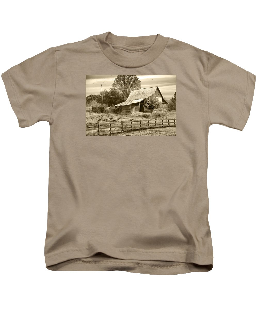 Abandoned Kids T-Shirt featuring the photograph Old Barn Sepia Tint by Susan Leggett