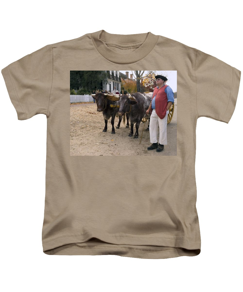 2 Oxen Walking Duke Of Glouster Street Kids T-Shirt featuring the photograph Oxen And Handler by Sally Weigand