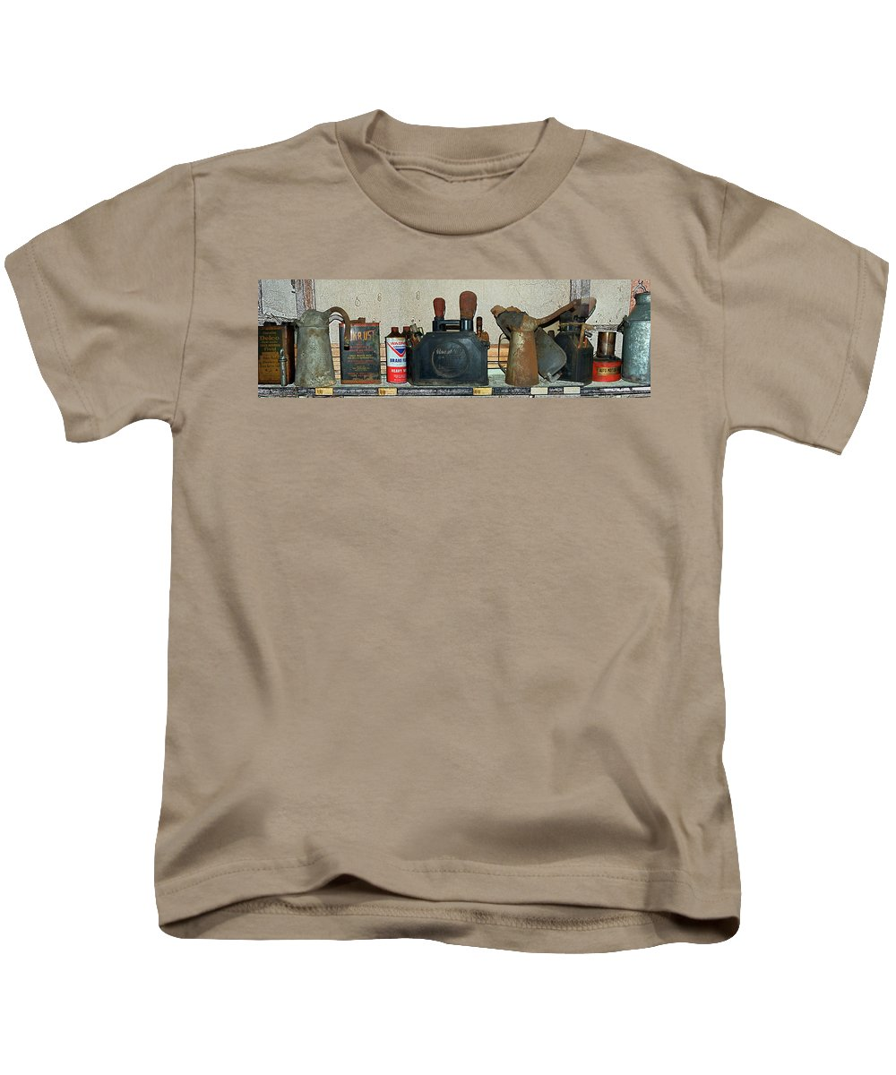 Mother Road Kids T-Shirt featuring the photograph Route 66 Odell Il Gas Station Shelf Items Digital Art by Thomas Woolworth