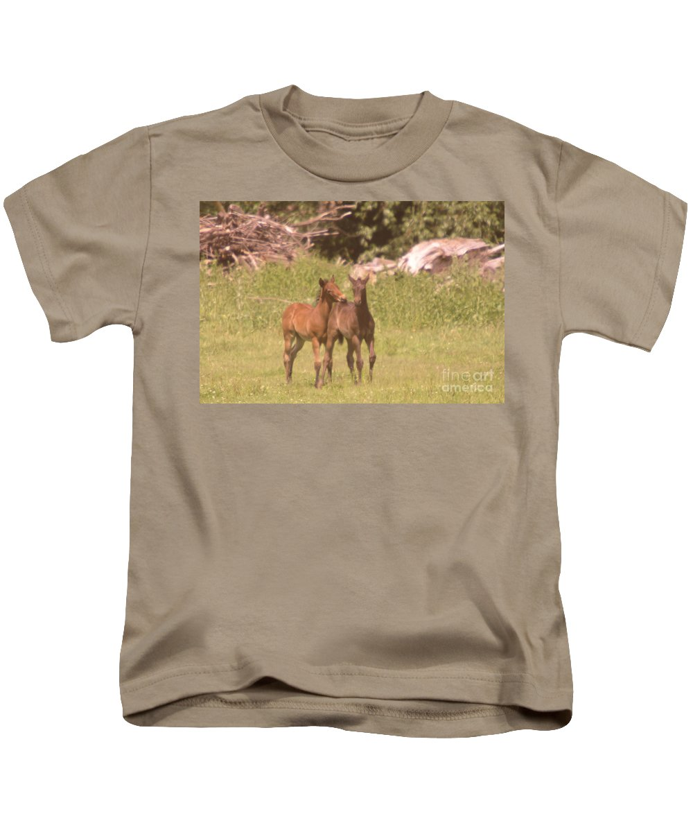 Horses Kids T-Shirt featuring the photograph Rump Biting by Jeff Swan