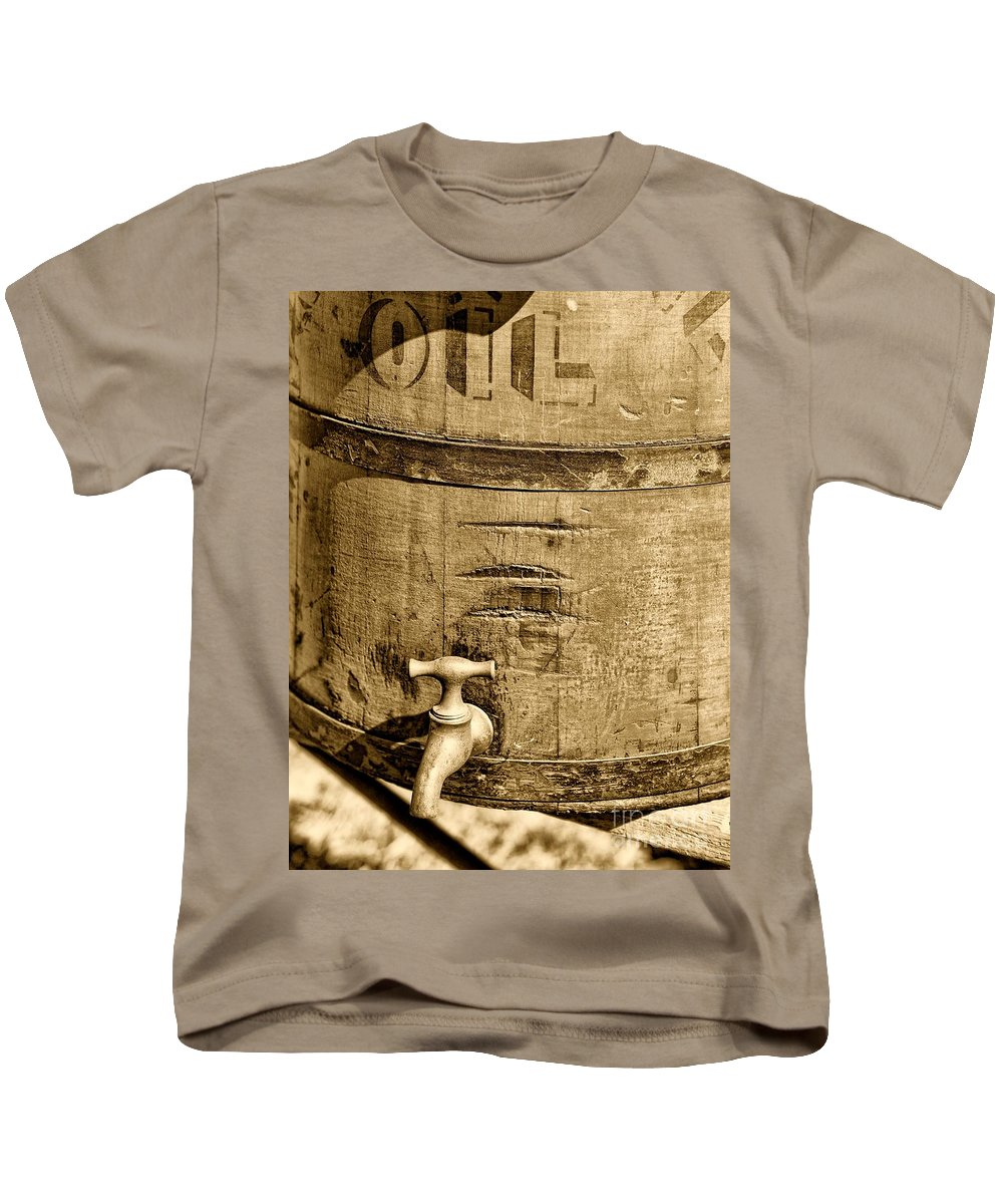 Weathered Red Oil Bucket Kids T-Shirt featuring the photograph Weathered Wooden Bucket In Sepia by Paul Ward