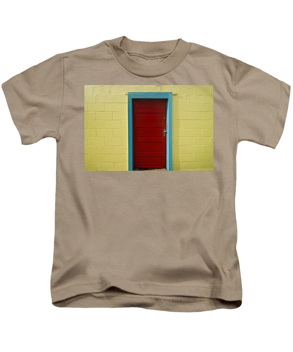 Aqua Kids T-Shirt featuring the photograph Yellow Wall And Red Door by Ray Laskowitz