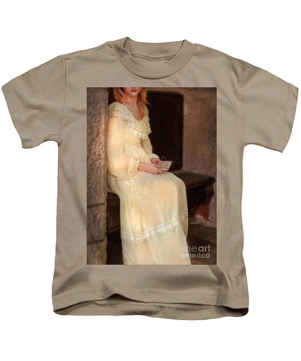 Lady Kids T-Shirt featuring the photograph Young Lady In Yellow Gown With Letters by Jill Battaglia