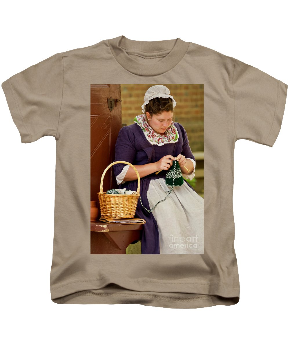 Colonial Williamsburg Kids T-Shirt featuring the photograph A Colonial Lady Knits by Rachel Morrison