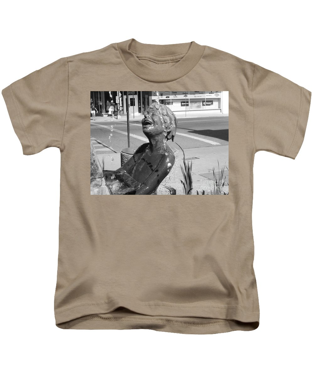 Boy In Fountain Sculture Kids T-Shirt featuring the photograph Boy In Fountain Sculture Grand Junction Co by Tommy Anderson